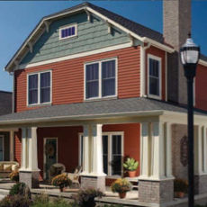 two story home with rust color siding and white trim